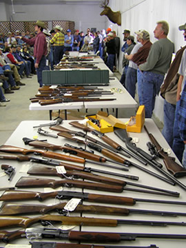 Live gun auction, Bott Realty